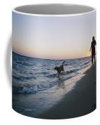 Woman And Dog Running On Beach, Nags Coffee Mug