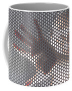 Woman Behind A Metal Mesh Coffee Mug