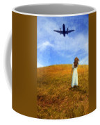 Woman In Field Looking Up At An Airplane Coffee Mug