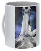 Woman On Rocks Coffee Mug