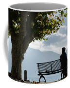 Woman Sitting On A Bench Coffee Mug