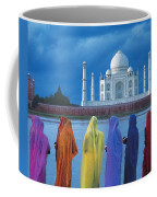 Women In Colorful Saris In Front Of The Coffee Mug