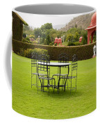 Wrought Metal Chairs Around A Table In A Lawn Coffee Mug