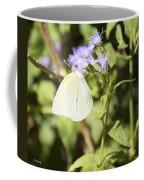 Yellow Butterfly Feeding On Violet Flower Coffee Mug