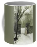 Young Lady By Stone Pillar In Snow Coffee Mug