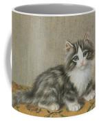 A Kitten On A Table Coffee Mug