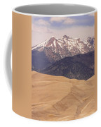 The Wind Carries Sand And Rocks From Many Miles Away. The Dunes Contain Areas Of Black Sand Which A Coffee Mug