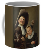 A Boy And A Girl With A Cat And An Eel Coffee Mug