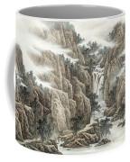 A Waterfall In The Mountains Coffee Mug