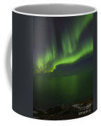 Aurora Borealis Over Iceland Shoreline Coffee Mug