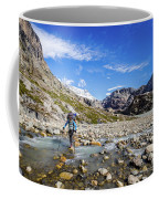 Crossing A River In Patagonia Coffee Mug