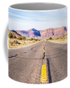descending into Monument Valley at Utah  Arizona border  Coffee Mug