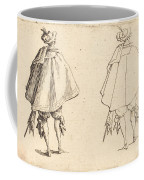 Gentleman In Large Mantle, Seen From Behind Coffee Mug