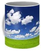 Green Rolling Hills Under Blue Sky Coffee Mug
