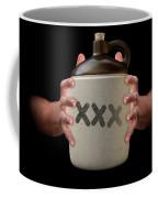 Hands Holding Moonshine Coffee Mug
