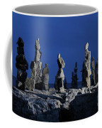 Human Figures Made From Stones At Night Coffee Mug