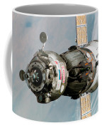 Iss Expedition 11 Crew Arriving Coffee Mug by NASA / Science Source
