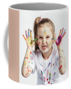 Little Girl Covered In Paint Making Funny Faces. Coffee Mug