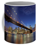 New York City Skyline By Night Coffee Mug