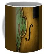 Old Violin Against Green Wall Coffee Mug