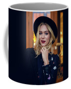 Portrait Of A Girl In Black Clothes And A Hat On The Street In The Evening Coffee Mug