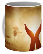 Raised Hands Catching Sun On Sunset Sky. Concept Of Spirituality, Wellbeing, Positive Energy Coffee Mug