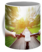 Riding A Bike First Person Perspective. Smartphone On Handlebar. Speed Motion Blur Coffee Mug
