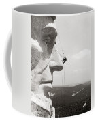 Scaling Mount Rushmore Coffee Mug