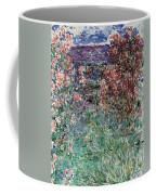 The House Among The Roses Coffee Mug