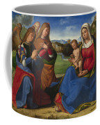 The Virgin And Child Adored By Two Angels Coffee Mug