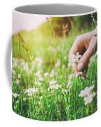 Woman Picking Up Flowers On A Meadow, Hand Close-up. Vintage Light Coffee Mug