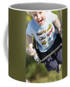 Young Boy Smiling Swinging In A Swing Coffee Mug