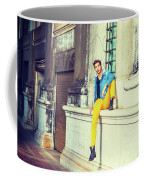 Young Man Relaxing On Street Coffee Mug