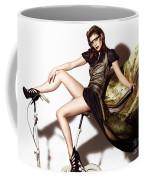 Young Woman In Long Dress On Exercise Bike Coffee Mug