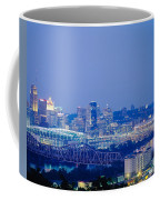 Buildings In A City Lit Up At Dusk Coffee Mug
