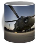 A Uh-60l Blackhawk Parked On Its Pad Coffee Mug