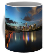 Clouds Roll Over The Austin Skyline As The Neon Reflects In The Glass-like Waters Of Lady Bird Lake Coffee Mug