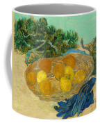 Still Life Of Oranges And Lemons With Blue Gloves Coffee Mug