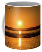 Sunset Over The Ocean Coffee Mug