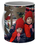 Two Children Sitting On A Bench With Candy Coffee Mug