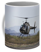 An Oh-58 Kiowa Helicopter Of The U.s Coffee Mug