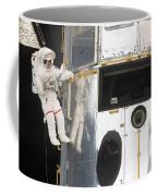 Astronauts Working On The Hubble Space Coffee Mug