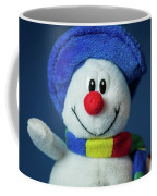 A Cute Little Soft Snowman With A Blue Hat And A Colorful Scarf Coffee Mug
