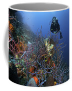 Scuba Diver Swims Underwater Amongst Coffee Mug by Terry Moore