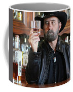 A Bearded Cowboy In Black Contemplates His Whiskey In A Saloon Coffee Mug