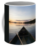 A Boat And Paddle On A Tranquil Lake Coffee Mug