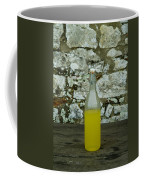 A Bottle Of Limoncello Sits On A Picnic Coffee Mug