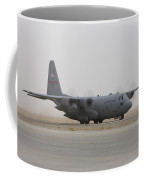 A C-130 Hercules Aircraft Taxis Coffee Mug by Terry Moore