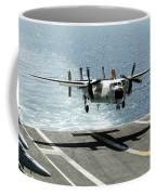 A C-2a Greyhound Prepares To Land Coffee Mug by Stocktrek Images