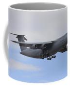 A C-5 Galaxy In Flight Over Nevada Coffee Mug by Remo Guidi